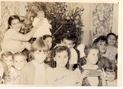 "Christmas 1949, Whitehead Street, Sandra's Birthday; Front row  beginning extreme left: Ceci Alonzo (partial face), unidentified boy, Rene Rego, Lucy Hooper, Sandra Beiro, unidentified girl, unidentified girl Middle row partially hidden Gladys Diaz, Manuel Fernandez, and full face: Lenny Alonzo, Ray Beiro Back row: Rosa Reyes holding Manuel ""Cookie"" Valdez"